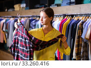 Woman choosing male clothes. Стоковое фото, фотограф Яков Филимонов / Фотобанк Лори