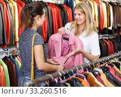 Купить «calm shopping assistant demonstrating female customer leather jackets in store», фото № 33260516, снято 5 сентября 2018 г. (c) Яков Филимонов / Фотобанк Лори