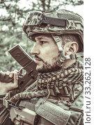 Купить «Handsome man in italian military uniform camouflage coloring Digital Vegetato», фото № 33262128, снято 22 апреля 2017 г. (c) katalinks / Фотобанк Лори