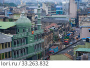 COLOMBO, SRI LANKA - FEBRUARY 22, 2020:  Umbichi Mosque in the cityscape in the early evening. Редакционное фото, фотограф Виктор Карасев / Фотобанк Лори