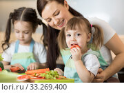 Positive family preparing lunch in the kitchen. Стоковое фото, фотограф Оксана Кузьмина / Фотобанк Лори