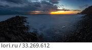 Купить «Panorama of three frames a general view of the rocky shore of the Black Sea coast after sunset, Anapa, Russia», фото № 33269612, снято 12 февраля 2020 г. (c) Иванов Алексей / Фотобанк Лори