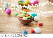 Купить «chocolate easter egg and candy drops on table», фото № 33269924, снято 15 марта 2018 г. (c) Syda Productions / Фотобанк Лори