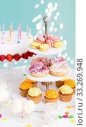 Купить «food and drinks on table at birthday party», фото № 33269948, снято 6 июля 2018 г. (c) Syda Productions / Фотобанк Лори