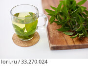 Купить «herbal tea with fresh peppermint on wooden board», фото № 33270024, снято 12 июля 2018 г. (c) Syda Productions / Фотобанк Лори