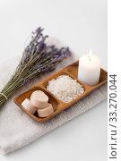 Купить «sea salt, soap, candle and lavender on bath towel», фото № 33270044, снято 8 ноября 2018 г. (c) Syda Productions / Фотобанк Лори