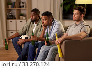 Купить «sad male friends or soccer fans with beer at home», фото № 33270124, снято 28 декабря 2019 г. (c) Syda Productions / Фотобанк Лори