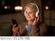 Купить «senior woman in headphones listening to music», фото № 33270188, снято 14 ноября 2019 г. (c) Syda Productions / Фотобанк Лори