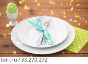 Купить «easter egg in cup holder, plates and cutlery», фото № 33270272, снято 15 марта 2018 г. (c) Syda Productions / Фотобанк Лори