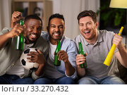 Купить «friends or soccer fans with ball and beer at home», фото № 33270432, снято 28 декабря 2019 г. (c) Syda Productions / Фотобанк Лори