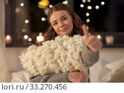 Купить «happy young woman with soft pillow in bed at home», фото № 33270456, снято 19 января 2020 г. (c) Syda Productions / Фотобанк Лори