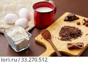 Купить «chocolate, cocoa powder, milk, eggs and flour», фото № 33270512, снято 1 февраля 2019 г. (c) Syda Productions / Фотобанк Лори