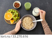 Купить «hands with oatmeal, fruits, nuts, juice and milk», фото № 33270616, снято 1 ноября 2018 г. (c) Syda Productions / Фотобанк Лори