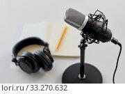 Купить «headphones, microphone and notebook with pencil», фото № 33270632, снято 17 мая 2019 г. (c) Syda Productions / Фотобанк Лори