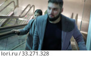 Купить «Focused people coming out of modern metro station, moving up on escalator», видеоролик № 33271328, снято 11 ноября 2019 г. (c) Яков Филимонов / Фотобанк Лори
