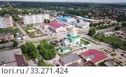 Купить «Aerial panoramic view of cityscape of Ozyory overlooking Orthodox Holy Trinity Cathedral, Russia», видеоролик № 33271424, снято 13 мая 2019 г. (c) Яков Филимонов / Фотобанк Лори