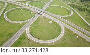 Купить «Panoramic aerial view of road junction in Russia from drone at sunny day», видеоролик № 33271428, снято 13 мая 2019 г. (c) Яков Филимонов / Фотобанк Лори