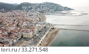 Купить «View from drone of famous tourist town of Roses on Catalan coast of Gulf of Roses, Costa Brava, Spain», видеоролик № 33271548, снято 10 февраля 2019 г. (c) Яков Филимонов / Фотобанк Лори