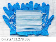 Lot medical respiratory face masks on blue gloves as background. Global pandemic insurance and airborne diseases, influenza, SARS. Стоковое фото, фотограф А. А. Пирагис / Фотобанк Лори