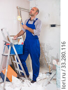 Man is standing with roller in uniform. Стоковое фото, фотограф Яков Филимонов / Фотобанк Лори
