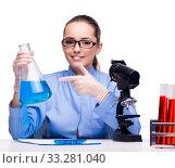 Lab chemist working with microscope and tubes. Стоковое фото, фотограф Elnur / Фотобанк Лори