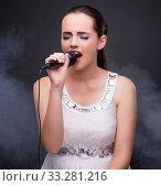 Young girl singing in karaoke club. Стоковое фото, фотограф Elnur / Фотобанк Лори