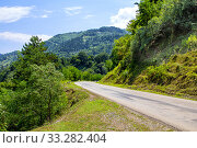 Купить «Turning mountain road. View of the Goderdzi pass. Caucasus Mountains. Georgia», фото № 33282404, снято 13 июля 2019 г. (c) Евгений Ткачёв / Фотобанк Лори