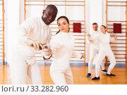 Купить «fencer practicing movements with african american trainer», фото № 33282960, снято 11 июля 2018 г. (c) Яков Филимонов / Фотобанк Лори