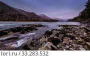Купить «Time lapse shot of a river near mountain forest. Huge rocks and fast clouds movenings.», видеоролик № 33283532, снято 13 апреля 2018 г. (c) Александр Маркин / Фотобанк Лори