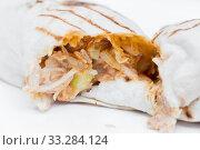 The cut shawarma in a lavash. Juicy stuffing of shawarma. Street food. Стоковое фото, фотограф Екатерина Кузнецова / Фотобанк Лори