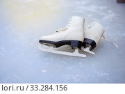 A pair of curly female skates lies on the ice at the rink. Стоковое фото, фотограф Екатерина Кузнецова / Фотобанк Лори