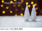 Купить «Two toy New Year trees against the background of fires. BOKEH», фото № 33284480, снято 10 августа 2018 г. (c) Екатерина Кузнецова / Фотобанк Лори