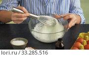 Купить «female hands whipping egg whites by whisk in bowl», видеоролик № 33285516, снято 18 февраля 2020 г. (c) Syda Productions / Фотобанк Лори