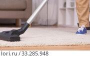 Купить «senior woman with vacuum cleaner cleaning at home», видеоролик № 33285948, снято 19 января 2020 г. (c) Syda Productions / Фотобанк Лори