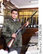 Portrait of nice confident man showing rifle. Стоковое фото, фотограф Яков Филимонов / Фотобанк Лори