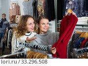 Купить «Women shopping in clothing boutique», фото № 33296508, снято 6 декабря 2018 г. (c) Яков Филимонов / Фотобанк Лори