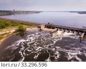 Купить «Concrete dam on water», фото № 33296596, снято 4 мая 2019 г. (c) Яков Филимонов / Фотобанк Лори