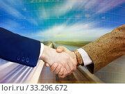 Купить «Handshake confirming business partnership», фото № 33296672, снято 19 июля 2012 г. (c) Яков Филимонов / Фотобанк Лори