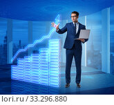 Купить «Businessman in stock exchange trading concept», фото № 33296880, снято 26 мая 2020 г. (c) Elnur / Фотобанк Лори