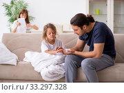 Купить «Father taking care of his ill daughter», фото № 33297328, снято 6 августа 2019 г. (c) Elnur / Фотобанк Лори