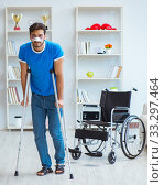 Купить «Young man recovering after surgery at home with crutches and a w», фото № 33297464, снято 26 июля 2017 г. (c) Elnur / Фотобанк Лори