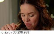 Купить «happy smiling pregnant woman eating salad at home», видеоролик № 33298988, снято 8 февраля 2020 г. (c) Syda Productions / Фотобанк Лори