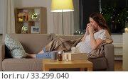 sick pregnant woman blowing nose at home. Стоковое видео, видеограф Syda Productions / Фотобанк Лори