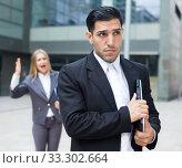 Купить «Employee is upset with the reprimand of woman boss», фото № 33302664, снято 20 августа 2017 г. (c) Яков Филимонов / Фотобанк Лори