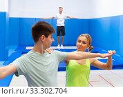 Купить «Teenager preparing to trampoline training», фото № 33302704, снято 25 мая 2020 г. (c) Яков Филимонов / Фотобанк Лори