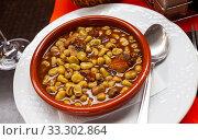 Купить «Stew of beans with sausages», фото № 33302864, снято 5 июля 2020 г. (c) Яков Филимонов / Фотобанк Лори