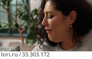 Купить «woman drinking tea and eating cake at home», видеоролик № 33303172, снято 24 февраля 2020 г. (c) Syda Productions / Фотобанк Лори