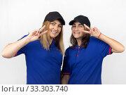 Купить «Portrait of two different-aged girls, in the same clothes», фото № 33303740, снято 3 ноября 2019 г. (c) Иванов Алексей / Фотобанк Лори