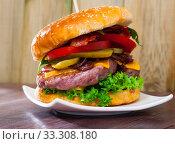 Купить «Double hamburger», фото № 33308180, снято 14 июля 2020 г. (c) Яков Филимонов / Фотобанк Лори