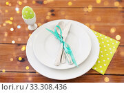 Купить «easter egg in cup holder, plates and cutlery», фото № 33308436, снято 15 марта 2018 г. (c) Syda Productions / Фотобанк Лори